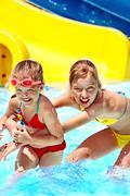 Children on water slide at aquapark. Stock Photos