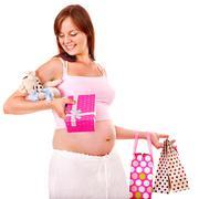 Pregnant woman with shopping bag. Stock Photos