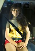 woman fastened by seat belt - stock photo