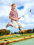 Little girl playing golf in park. Stock Photos