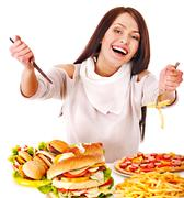 woman eating fast food. - stock photo