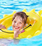kid sitting on inflatable ring. - stock photo