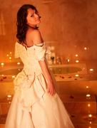 woman in  wedding dress relaxing in bath. - stock photo