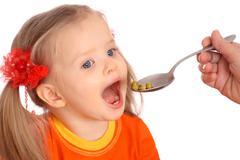 Feeding of baby girl pear. Stock Photos