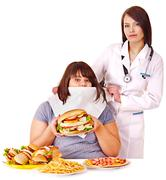 woman with hamburger and doctor. - stock photo