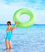 child holding inflatable ring.. - stock photo