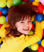 little girl with group ball. - stock photo