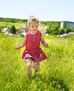 Portrait of running  kid outdoor. Stock Photos