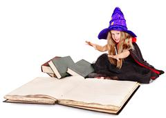 Stock Photo of witch little girl holding  book.