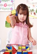 Child playing block at home. - stock photo