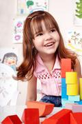 child with  block and construction set in play room. - stock photo