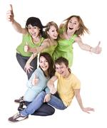 group of people throwing out thumbs super. - stock photo