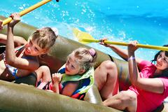 Stock Photo of family ride rubber boat.