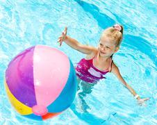 girl swimming in pool. - stock photo