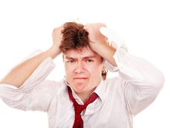 businessman with hand on head in crisis. - stock photo