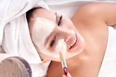 cosmetician make mask. facial massage. - stock photo