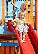 Children move out to slide in playground Stock Photos