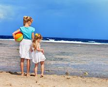 Children holding hands walking on the beach. Stock Photos