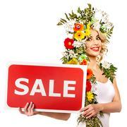 Nainen, jolla myynti bannerin ja kukka. Kuvituskuvat