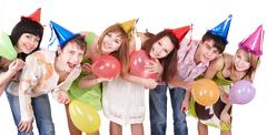 Group of teenagers celebrate birthday. Stock Photos