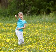 Happy child showing thumbs up at  field. Stock Photos
