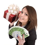 Stock Photo of girl in business suit  with money, red gift box.