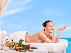 Stock Photo of woman getting spa treatment outdoor.