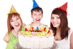 Group of people in party hat with cake celebrate happy birthday. Stock Photos