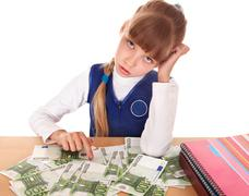 Stock Photo of sad child with money dollar.