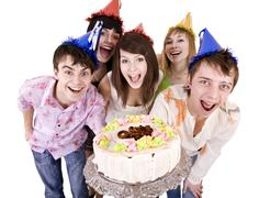 Group of teenagers celebrate happy birthday. Stock Photos