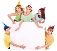 Group of young people in party hat. Stock Photos