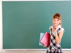 happy schoolchild in classroom. - stock photo
