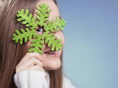 The girl with a green snowflake Stock Photos