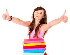 Stock Photo of girl with pile book showing thumb up.
