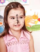 Child with paint of face. Stock Photos