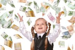 Child with flying money. Stock Photos