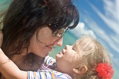 Woman in sunglasses and baby. Stock Photos