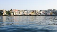 Long shot of houses in the port of Procida Stock Photos