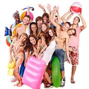 group people holding beach accessories. - stock photo