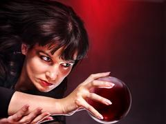 Young woman  with crystal ball. Stock Photos