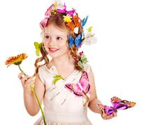 Stock Photo of child in spring hairstyle and butterfly.