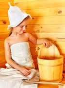 child relaxing at sauna. - stock photo