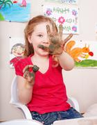 Child  playing with  clay in play room. Stock Photos