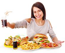 Stock Photo of woman eating fast food.