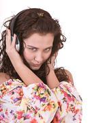 Girl in summer dress listen music. Stock Photos