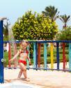 Child in red bikini take shower. Stock Photos