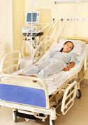 Woman on gurney in operating room. Stock Photos
