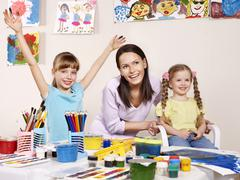 child painting in preschool. - stock photo