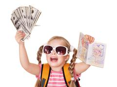 Stock Photo of child holding international passport and money.