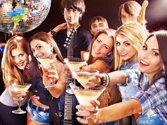Woman on disco in night club. Stock Photos